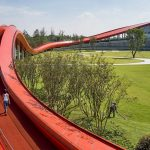 Powerhouse Company tops reception building with undulating Loop of Wisdom walking trail
