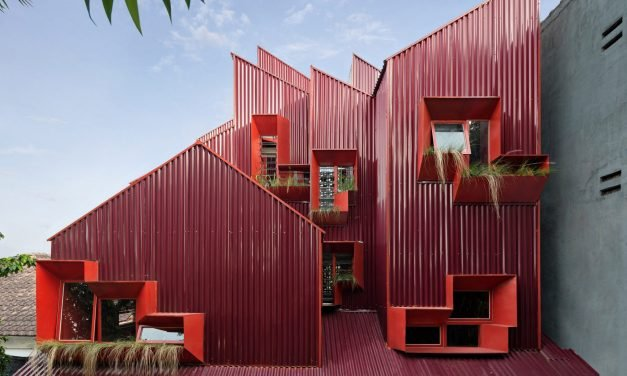captivating bright red Indonesian boarding house